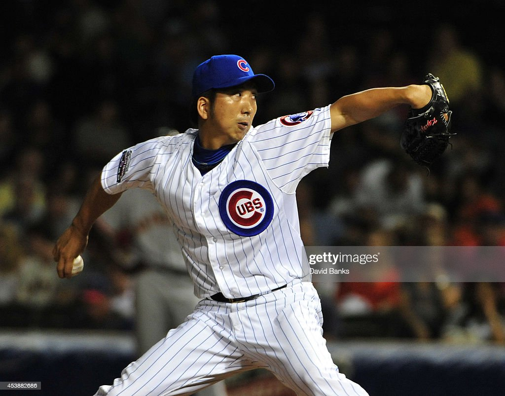 <a gi-track='captionPersonalityLinkClicked' href=/galleries/search?phrase=Kyuji+Fujikawa&family=editorial&specificpeople=807185 ng-click='$event.stopPropagation()'>Kyuji Fujikawa</a> #11 of the Chicago Cubs pitches against the San Francisco Giants during the eighth inning on August 20, 2014 at Wrigley Field in Chicago, Illinois.