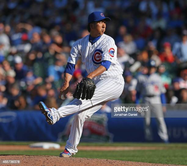 Kyuji Fujikawa of the Chicago Cubs pitches in the 7th inning against the Los Angeles Dodgers at Wrigley Field on September 19 2014 in Chicago Illinois