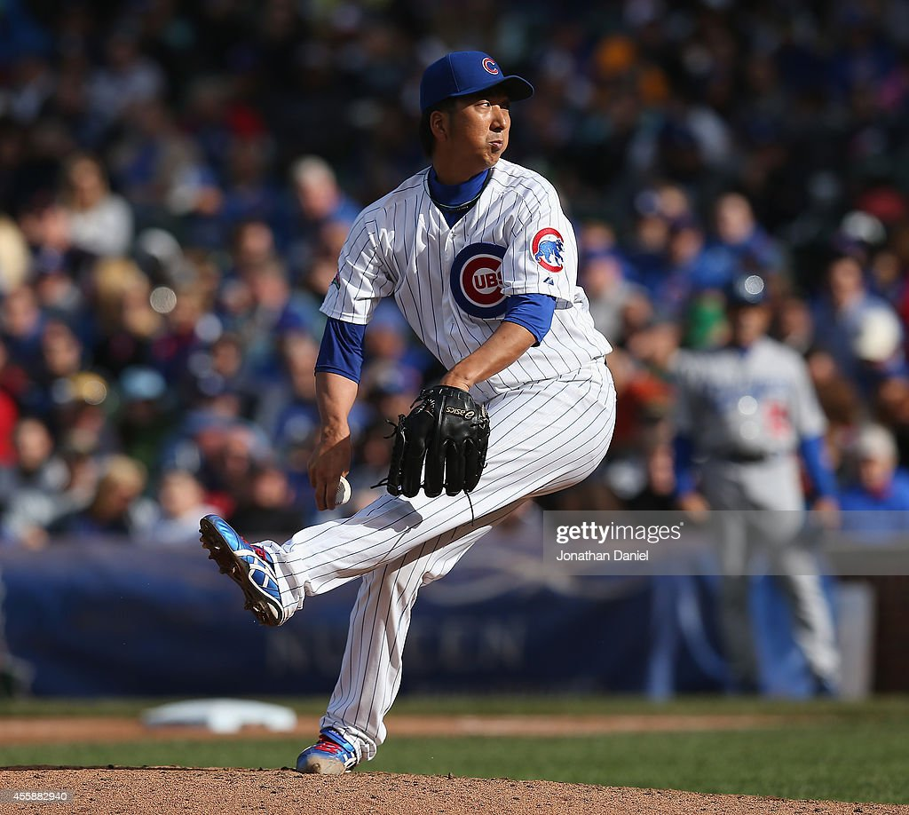 Kyuji Fujikawa #11 of the Chicago Cubs pitches in the 7th inning against the Los Angeles Dodgers at Wrigley Field on September 21, 2014 in Chicago, Illinois.