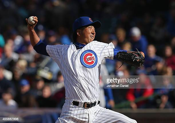 Kyuji Fujikawa of the Chicago Cubs pitches in the 7th inning against the Los Angeles Dodgers at Wrigley Field on September 21 2014 in Chicago Illinois