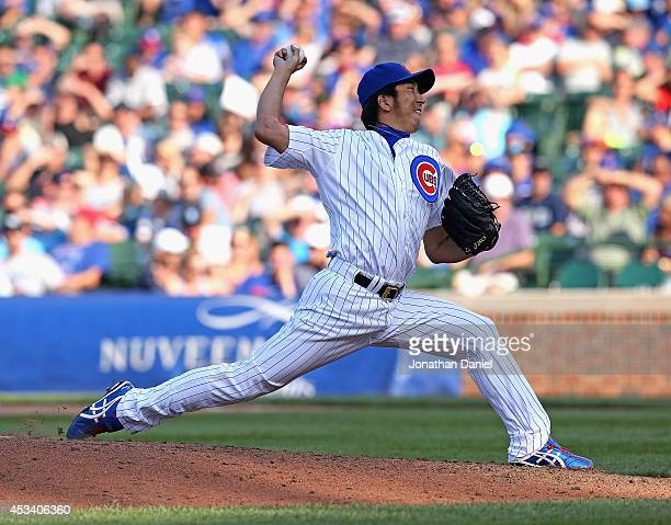 Kyuji Fujikawa of the Chicago Cubs pitches in the 9th inning against the Tampa Bay Rays at Wrigley Field on August 9 2014 in Chicago Illinois The...