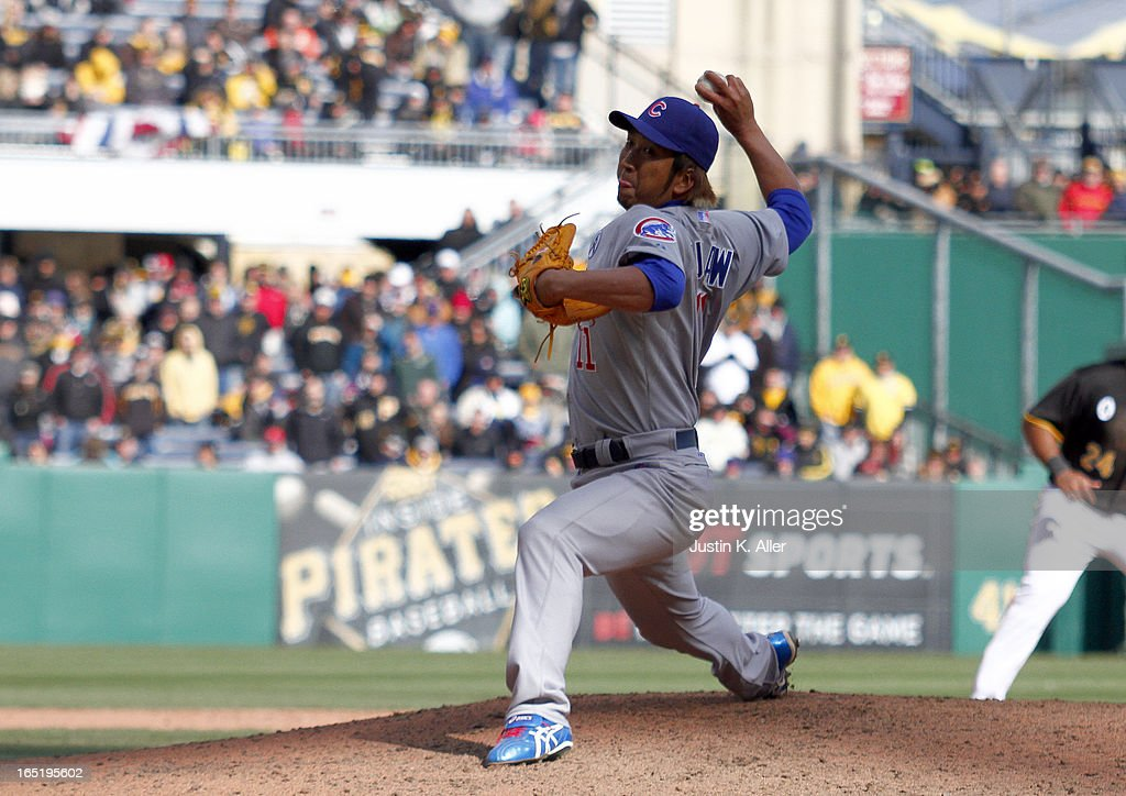 <a gi-track='captionPersonalityLinkClicked' href=/galleries/search?phrase=Kyuji+Fujikawa&family=editorial&specificpeople=807185 ng-click='$event.stopPropagation()'>Kyuji Fujikawa</a> #11 of the Chicago Cubs pitches in the ninth inning against the Pittsburgh Pirates during the opening day game on April 1, 2013 at PNC Park in Pittsburgh, Pennsylvania. The Cubs defeated the Pirates 3-1.