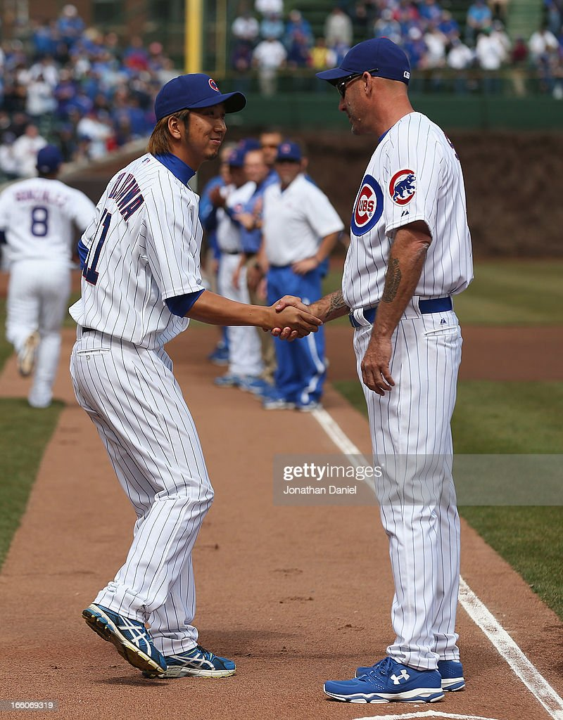 Kyuji Fujikawa #11 of the Chicago Cubs shakes hands with manager Dale Sveum #44 during player introductions before the Opening Day game against the Milwaukee Brewers at Wrigley Field on April 8, 2013 in Chicago, Illinois.
