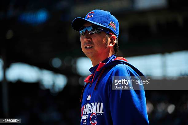 Kyuji Fujikawa of the Chicago Cubs walks on the field before the game against the Milwaukee Brewers on August 14 2014 at Wrigley Field in Chicago...