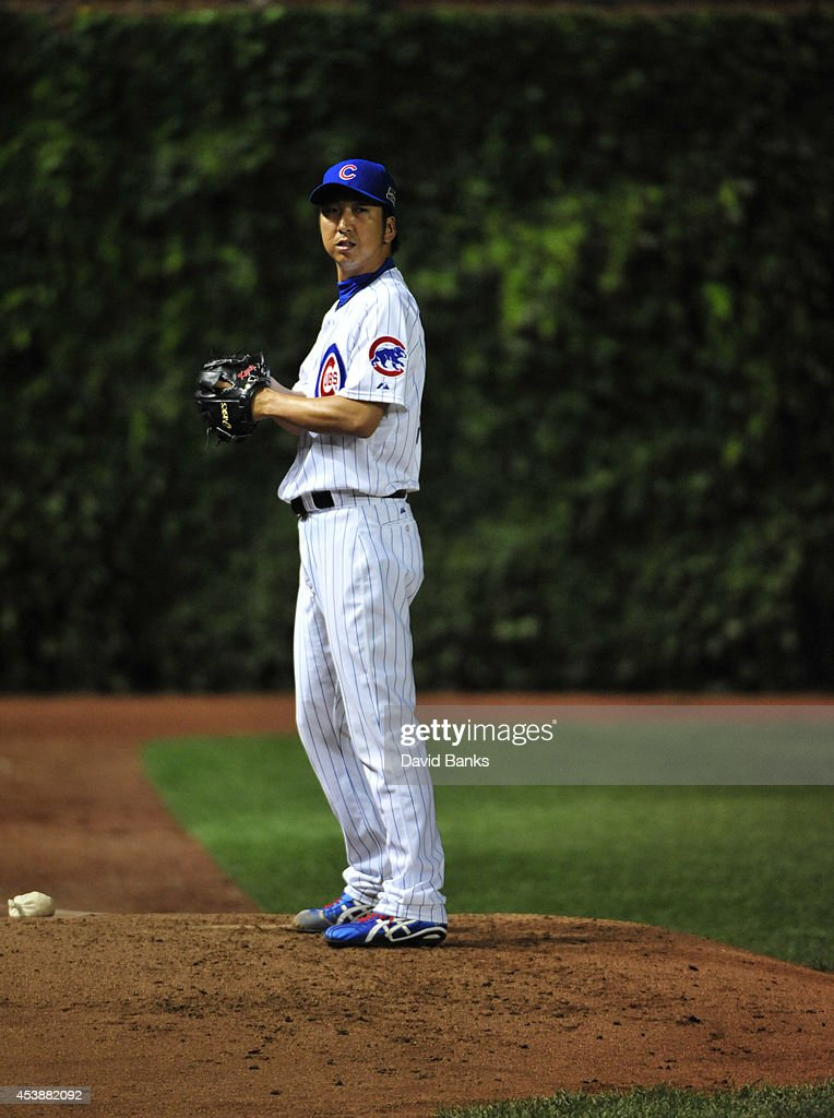 <a gi-track='captionPersonalityLinkClicked' href=/galleries/search?phrase=Kyuji+Fujikawa&family=editorial&specificpeople=807185 ng-click='$event.stopPropagation()'>Kyuji Fujikawa</a> #11 of the Chicago Cubs warms up in the bullpen during the seventh inning on August 20, 2014 at Wrigley Field in Chicago, Illinois.
