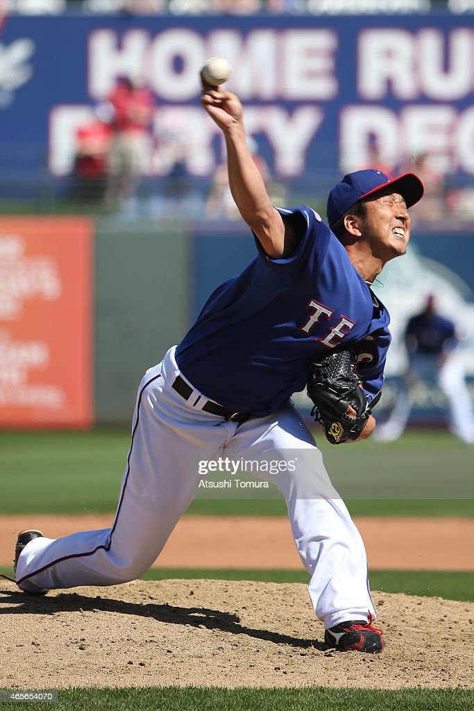 Kyuji Fujikawa of the Texas Rangers pitches during the spring training game between the Texas Rangers and Cleveland Indians at the Surprise Stadium...