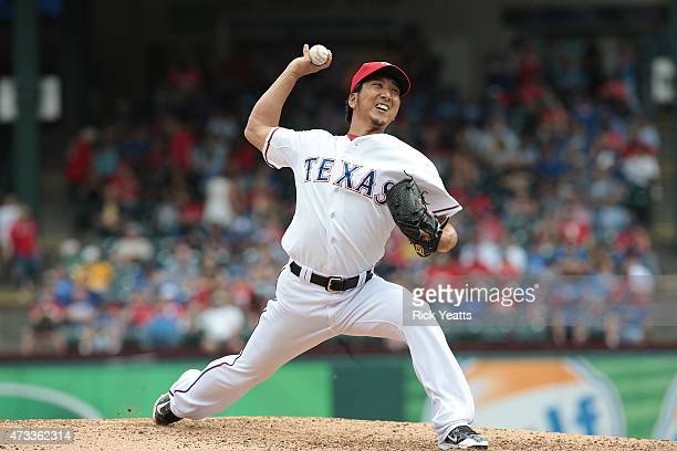 Kyuji Fujikawa of the Texas Rangers pitches in the eighth inning against the Kansas City Royals at Globe Life Park in Arlington on May 14 2015 in...