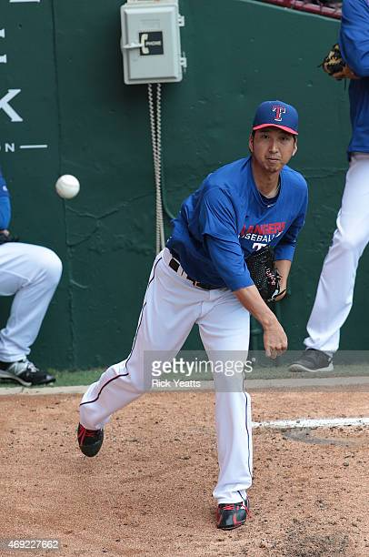 Kyuji Fujikawa of the Texas Rangers warms up in the bullpen before the game against the Houston Astros on Rangers opening day game at Globe Life Park...