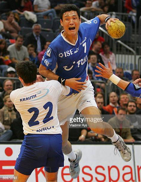KyungShin Yoon of Gummersbach jumps over Igor Lavrov of Gummersbach during the Bundesliga match between VFL Gummersbach and HSV Handball at the...