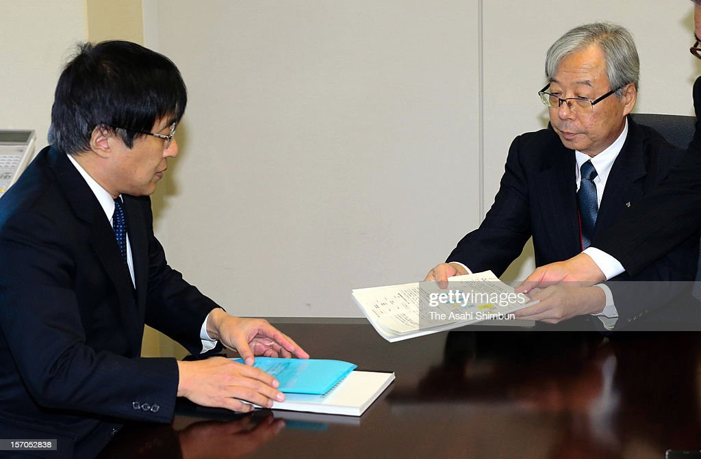 Kyushu Electric Power Co president Michiaki Uriu hands in the electricity rate increase request on November 26, 2012 in Tokyo, Japan. The power company, had relied on nuclear power for their 40 percent of the output, files the electricity price increase request to Ministry of Economy, Trade and Industry, with the avarage rise for households in their area will be 8.51 percent.