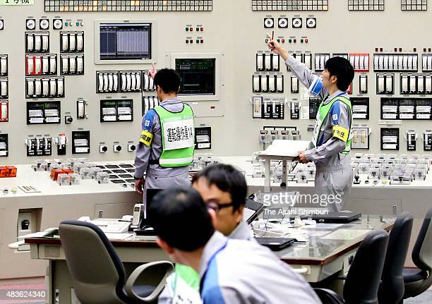Kyushu Electric Power Co workers activates the No 1 reactor of the Sendai nuclear power plant on August 11 2015 in Satsumasendai Kagoshima Japan It...