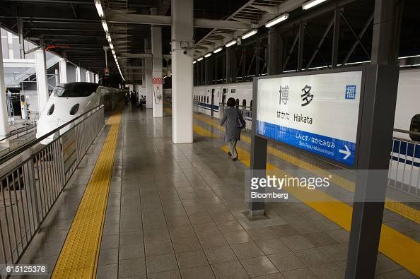 A Kyushu Railway Co 800 series Shinkansen bullet train left stops at Hakata Station in Fukuoka Fukuoka Prefecture Japan on Tuesday Oct 11 2016 JR...