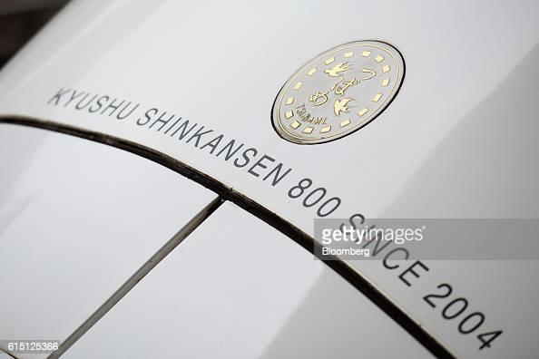 A Kyushu Railway Co 800 series Shinkansen bullet train stops at Hakata Station in Fukuoka Fukuoka Prefecture Japan on Tuesday Oct 11 2016 JR Kyushu...