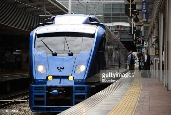 A Kyushu Railway Co 883 series Sonic limited express train stops at Hakata Station in Fukuoka Fukuoka Prefecture Japan on Tuesday Oct 11 2016 JR...