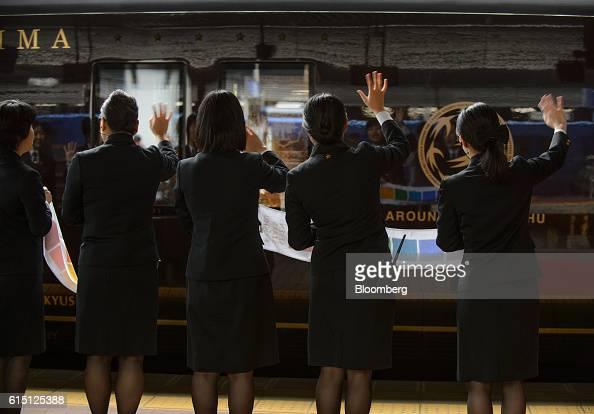 Kyushu Railway Co employees wave off the company's Seven Stars in Kyushu luxury train at Hakata Station in Fukuoka Fukuoka Prefecture Japan on...