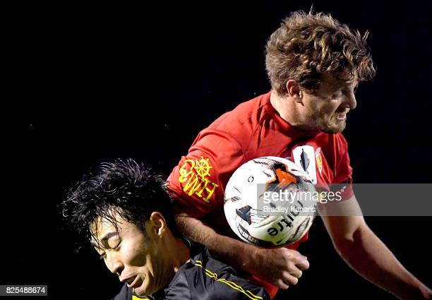 Kyusub Bang of Moreton Bay and Shane Paul of the Magic challenge for the ball during the FFA Cup round of 32 match between Moreton Bay United FC and...