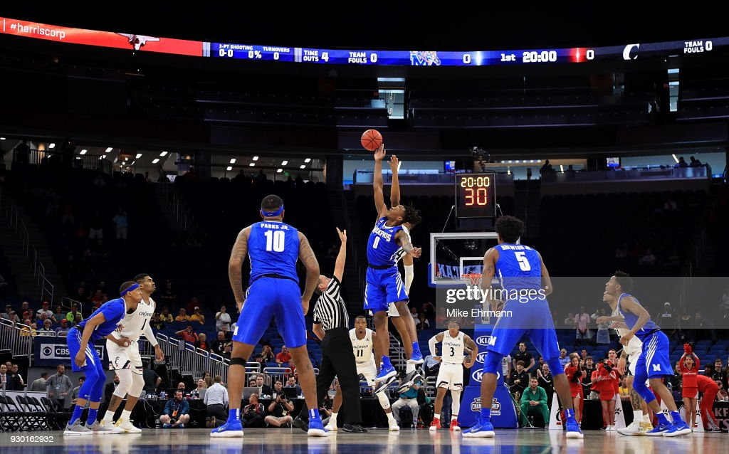Kyvon Davenport #0 of the Memphis Tigers and Kyle Washington #24 of the Cincinnati Bearcats jump ball during a semifinal game of the 2018 AAC Basketball Championship at Amway Center on March 10, 2018 in Orlando, Florida.