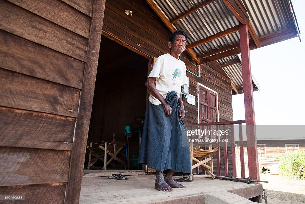 U Kywak Ni, 60, on his porch at a government-built resettlement camp on January 26, 2013. The lifelong farmer says he was given no choice and meager compensation when authorities demanded he vacate his land to make way for a copper mine project.