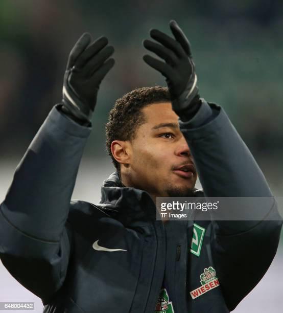 l Serge Gnabry of Werder Bremen celebrate their win after the Bundesliga match between VfL Wolfsburg and Werder Bremen at Volkswagen Arena on...