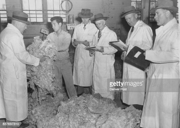 OCT 28 1952 OCT 29 1952 l to r J S Stressenger Paul Dolan J W Alibezette James Gilbert and J B Stressenger wool buyers from Boston and Chicago...