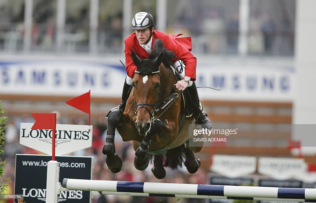 Germany's Marcus Ehning on his horse Noltes Kuchengirl clears a jump during the second stage of the Grand Prix Longines 07 May 2006 in La Baule AFP...