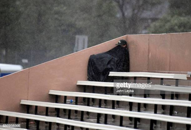 lA brave Vista fan takes cover as rain falls during the game with Mountain Vista and Rocky Mountain during the 2017 CHSAA Boys Baseball Championships...