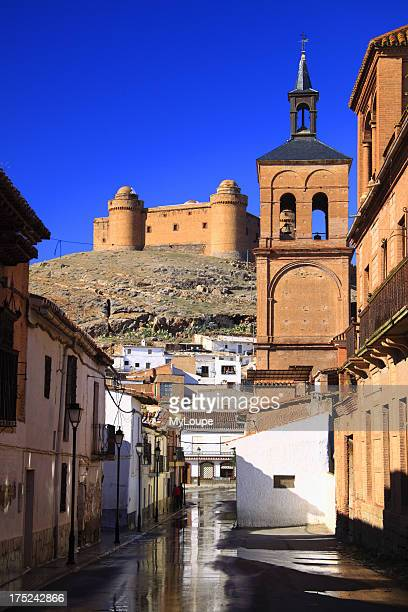 La Calahorra street with castle view and reflections on the foot of Sierra Nevada Granada province Spain