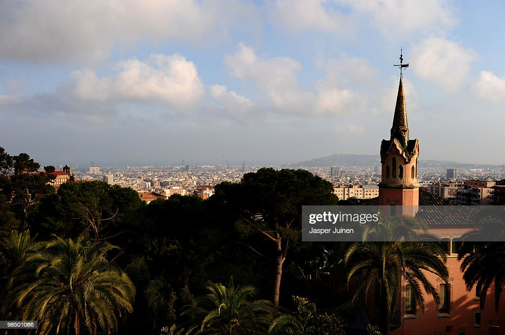 La Casa-Museo Gaudi, designed by architect Francesc Berenguer, is lit by the evening sun while backdropped by the city of Barcelona in Parque Guell on April 16, 2010 in Barcelona, Spain. La Casa-Museo Gaudi is the house where Catalan architect Antoni Gaudi lived from 1906 until a couple of months before his death in 1926.