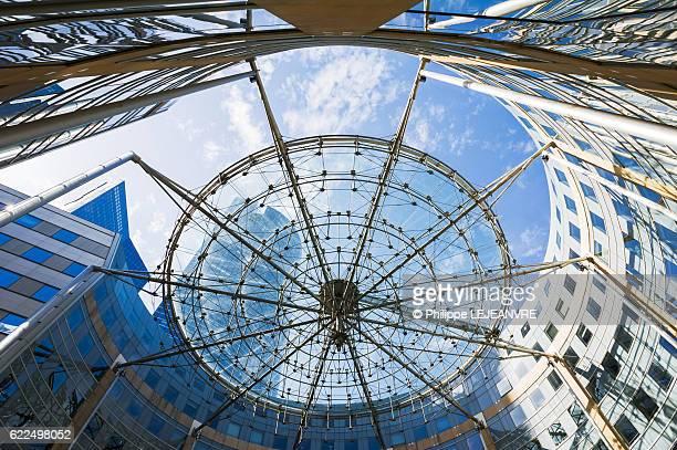 La Defense Paris financial district - Circular building against blue sky