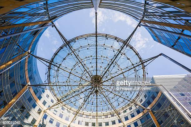 La Defense Paris - Financial district: Les Villages de l'Arche building against blue sky