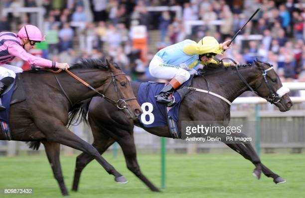 La Fortunata ridden by Andrea Atzeni goes on to win the EBF Oasis Dream Foillies Handicap Stakes ahead of Swiss Dream ridden by Nicky Mackay during...