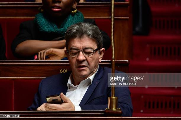 La France Insoumise Leader JeanLuc Melenchon checks his mobile phone during a session of questions to the government at the National Assembly in...