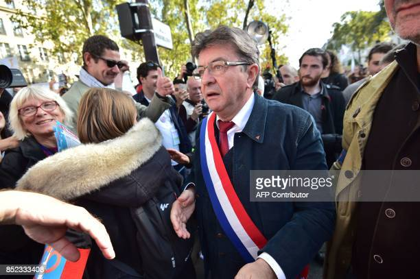 La France Insoumise leftist party parliamentary group President JeanLuc Melenchon walks during a protest over the government's labour reforms place...
