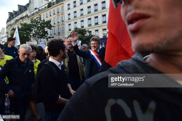 La France Insoumise leftist party parliamentary group President JeanLuc Melenchon waves during a protest over the government's labour reforms in...