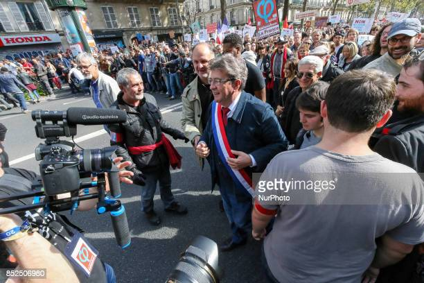 La France Insoumise leftist party parliamentary group President JeanLuc Melenchon walk during a protest organized in Paris on September 23 2017 by La...
