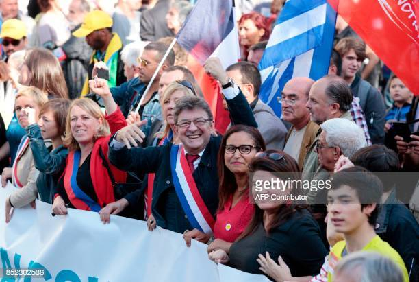 La France Insoumise leftist party parliamentary group President JeanLuc Melenchon flanked by party's spokeperson Raquel Garrido gestures during a...