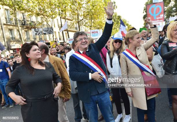 La France Insoumise leftist party parliamentary group President JeanLuc Melenchon flanked by LFI MP Clementine Autain and spokeperson Raquel Garrido...