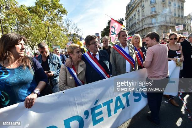 La France Insoumise leftist party parliamentary group President JeanLuc Melenchon flanked by LFI MP Clementine Autain walks during a protest over the...