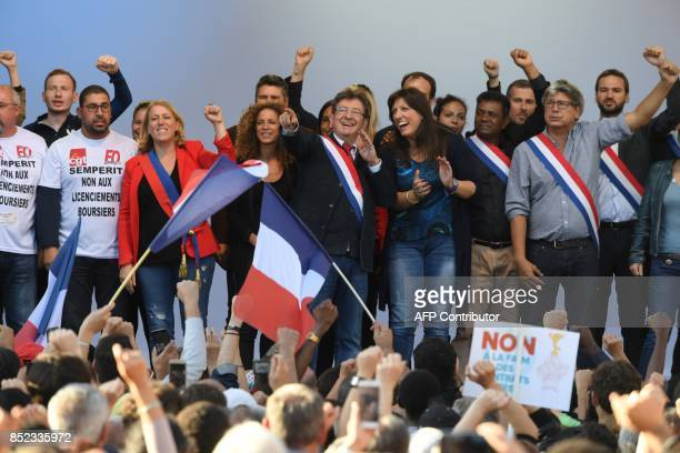 La France Insoumise leftist party parliamentary group President JeanLuc Melenchon flanked by protestors and party's members gestures on stage during...
