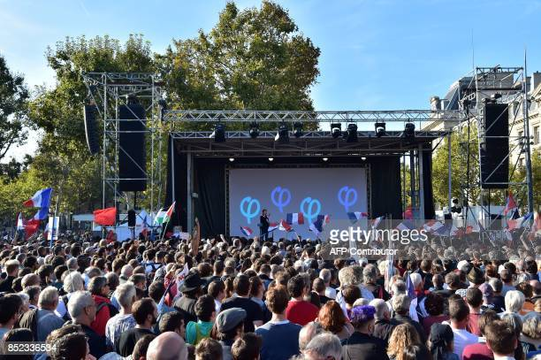 La France Insoumise leftist party parliamentary group President JeanLuc Melenchon speaks on stage during a protest over the government's labour...