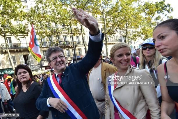 La France Insoumise leftist party parliamentary group President JeanLuc Melenchon waves flanked by LFI MP Clementine Autain during a protest over the...