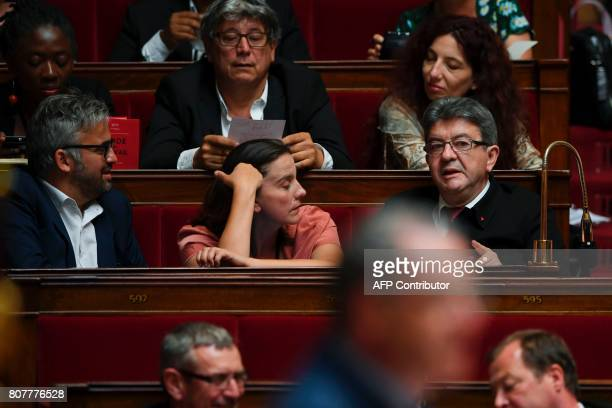 La France Insoumise leftist party's lawmakers Alexis Corbiere Caroline Fiat and party leader JeanLuc Melenchon attend the address of the French Prime...