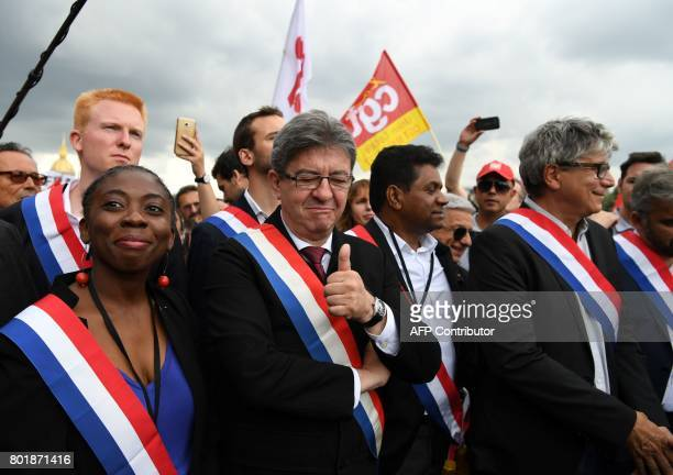 La France Insoumise leftist party's leader and Member of Parliament JeanLuc Melenchon flanked by MP of LFI Danielle Obono gestures as he arrives at a...