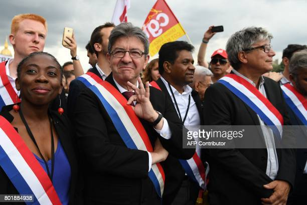 TOPSHOT La France Insoumise leftist party's leader and Member of Parliament JeanLuc Melenchon flanked by MP of LFI Danielle Obono gestures as he...