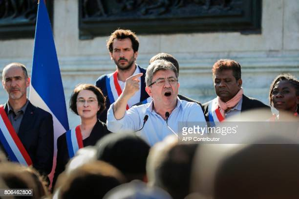 La France Insoumise leftist party's leader and Member of Parliament JeanLuc Melenchon delivers a speech as LFI lawmakers Daniele Obono Loic Prudhomme...