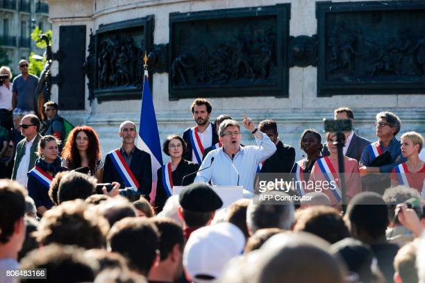 La France Insoumise leftist party's leader and Member of Parliament JeanLuc Melenchon delivers a speech as LFI lawmakers Daniele Obono Clementine...