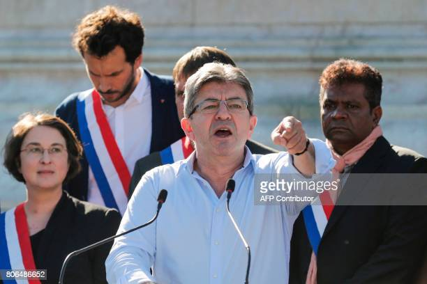La France Insoumise leftist party's leader and Member of Parliament JeanLuc Melenchon delivers a speech as LFI lawmakers Muriel Ressiguier Bastien...