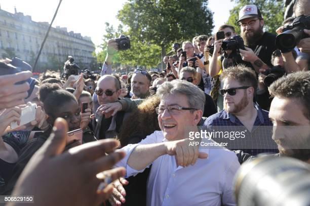 La France Insoumise leftist party's leader and Member of Parliament JeanLuc Melenchon reacts as he attends a gathering on Place de la Republique on...