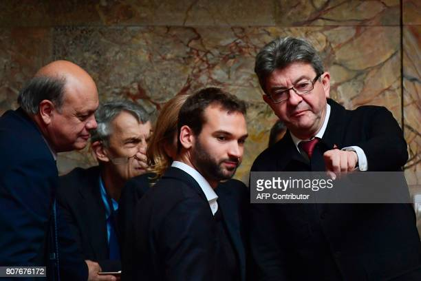 La France Insoumise leftist party's leader and Member of Parliament JeanLuc Melenchon gestures next to LFI lawmaker Ugo Bernalicis as they arrive to...