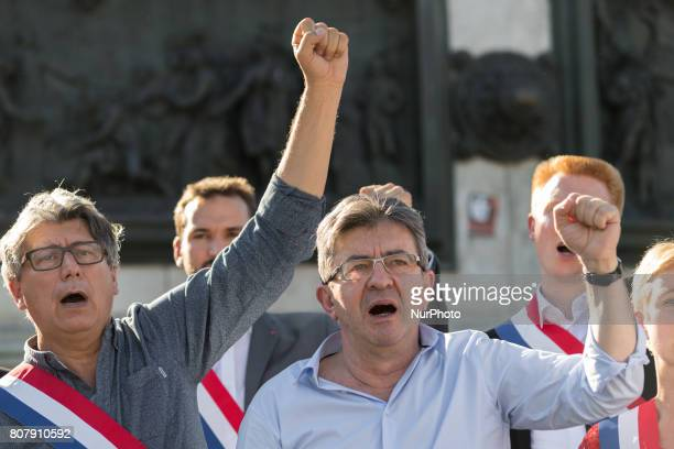 La France Insoumise leftist party's leader and Member of Parliament JeanLuc Melenchon and Francois Ruffin gesture and sing during a gathering on...